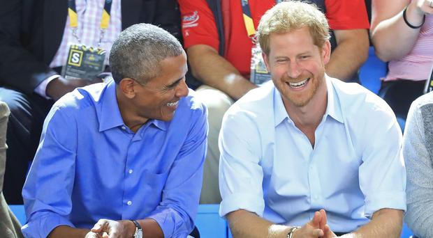 Former US president Barrack Obama and Prince Harry at the Invictus Games (Danny Lawson/PA)