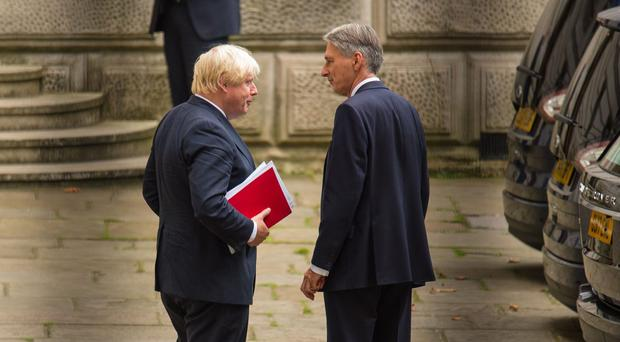 Philip Hammond has denied rumours of a 4am text sent to Boris Johnson as the general election results came in (Dominic Lipinski/PA)