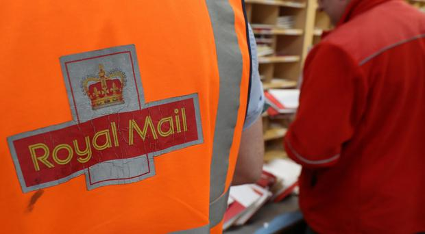 The Royal Mail is facing the threat of the first national strike since it was privatised after workers voted massively in favour of industrial action (Andrew Milligan/PA)