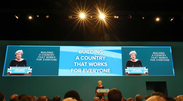 Theresa May's keynote speech was marred with distractions (Owen Humphreys/PA)