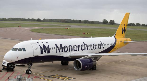 Monarch passengers who were abroad when the airline collapsed are returning to the UK (Steve Parsons/PA)