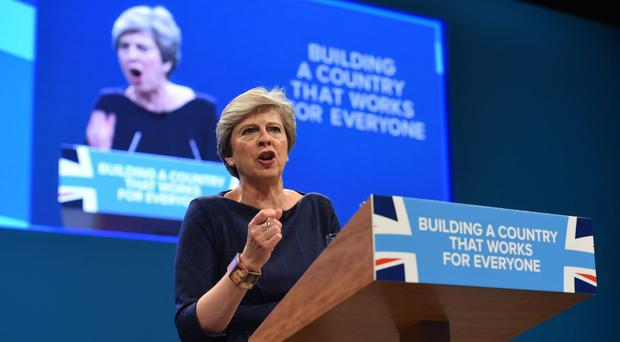 Theresa May during her keynote speech at the Conservative Party conference (Joe Giddens/PA)