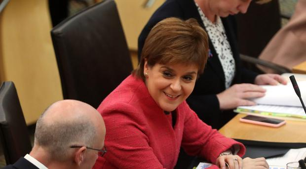 Nicola Sturgeon in the debating chamber for First Minister's Questions at the Scottish Parliament in Edinburgh (Andrew Milligan/PA Wire)