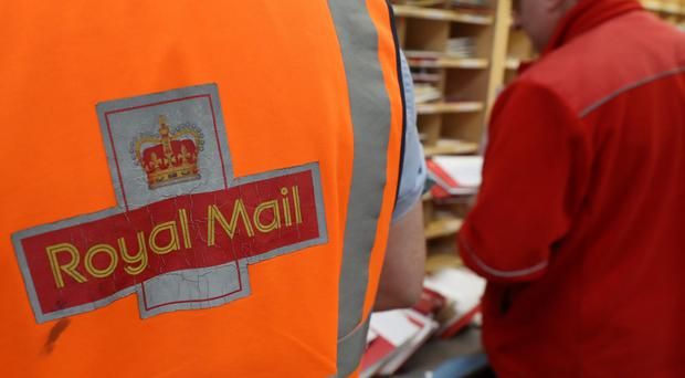 Royal Mail says it is planning legal action against the CWU (Andrew Milligan/PA)