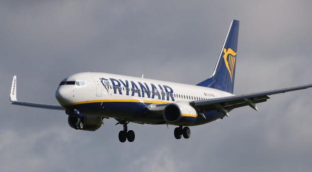 Ryanair has cancelled tens of thousands of flights (Niall Carson/PA)
