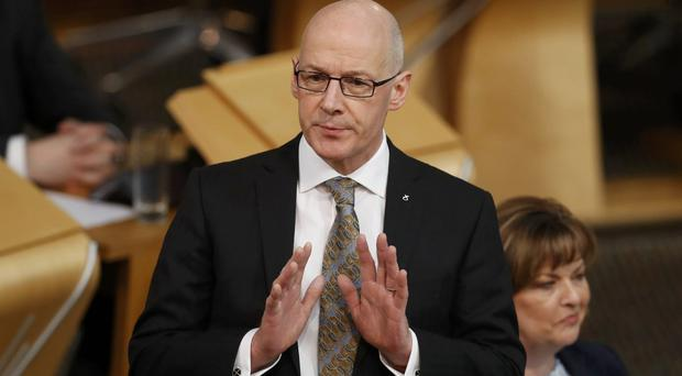 John Swinney is to deliver the opening address at the SNP conference (Russell Cheyne/PA)