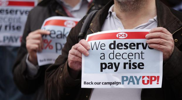 The PCS union estimates that civil servants' pay has fallen by up to £3,500 a year since 2010 (PA)