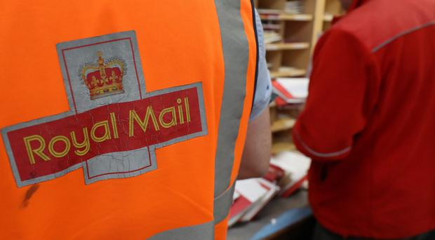 Royal Mail wrote to the CWU invoking a 'legally-binding' external mediation process (Andrew Milligan/PA)
