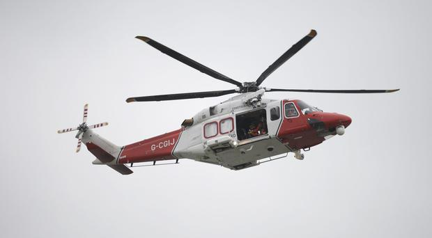 The UK Coastguard helicopter was asked to assist (Andrew Matthews/PA)