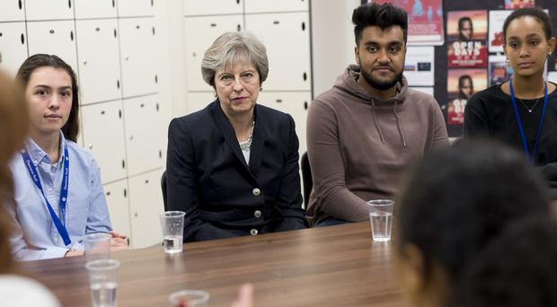 Theresa May during a visit to Dunraven School in Streatham, south London (Geoff Pugh/Daily Telegraph/PA)