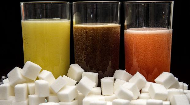 Fizzy drinks should carry labels warning over sugar content, the NHS England boss said (Anthony Devlin/PA)