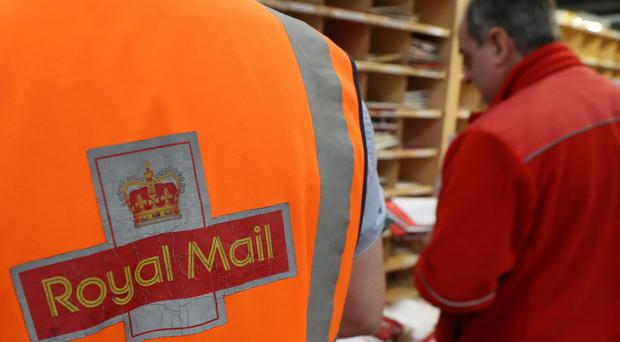 The Royal Mail has won an injunction preventing next week's 48-hour strike by postal workers (Andrew Milligan/PA)