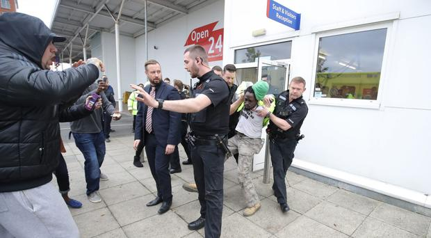 A former security worker at Tesco who staged a day-long protest in the roof space of a store to demonstrate against his sacking has been arrested (Steve Parsons/PA)