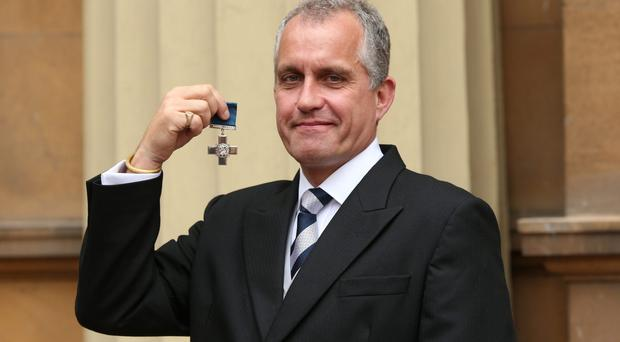 Dominic Troulan, a retired Major who repeatedly risked his life to save about 200 people caught up in a terrorist attack in a Kenyan shopping centre, after being awarded the George Cross during an Investiture ceremony at Buckingham Palace (Jonathan Brady/PA Wire)