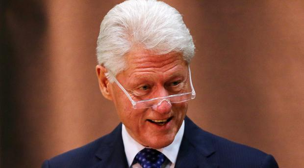 Ophelia forces Bill Clinton to postpone intervention in political stalemate (Niall Carson/PA)