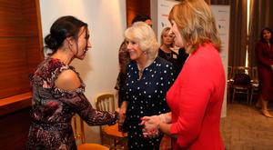 The Duchess of Cornwall greets Christine Lampard (left) with ITV's Jane Luca (right) at the Women of the Year Lunch at the InterContinental Hotel, in Mayfair, London