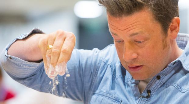 Jamie Oliver's restaurant chain added a 10p levy to non-alcoholic sugar sweetened beverages (Dominic Lipinski/PA)