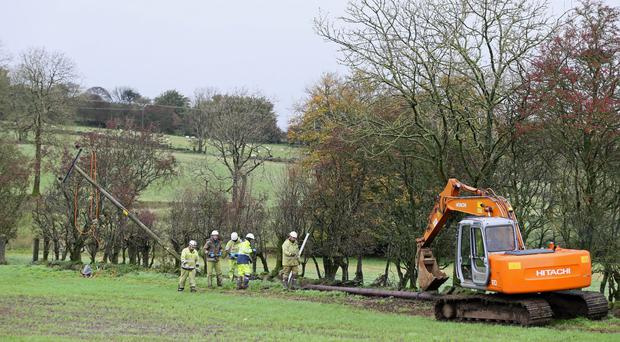 Emergency crew from NI Networks working on a fallen electricity poll in Doagh, Ballyclare (Brian Lawless/PA)