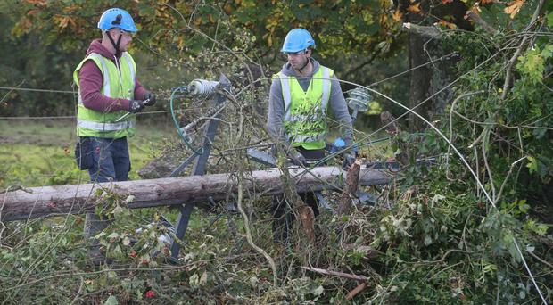 Workers in Kilcock clear fallen power lines after Hurricane Ophelia (Niall Carson/PA)