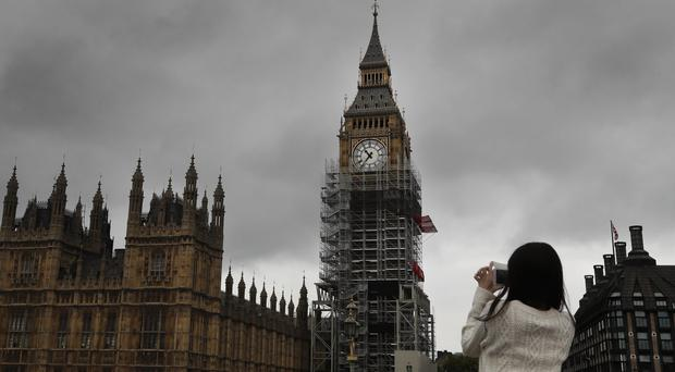 Big Ben to bong again but public warned not to set their watches by it (Kirsty Wigglesworth/AP)