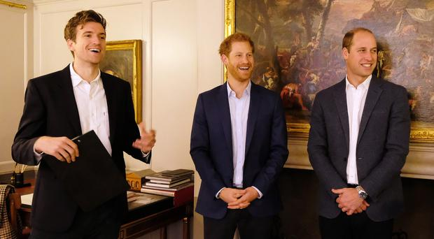 William and Harry with Greg James during a reception at Kensington Palace for the winners and finalists of BBC Radio 1's Teen Awards (BBC/PA)