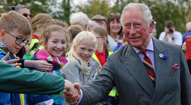 The Prince of Wales meets well-wishers outside the Eglinton Community Centre in Londonderry (Laura Hutton/PA)