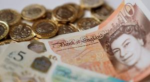 Workers in the public sector were paid on average 0.6% less than their private sector counterparts (Gareth Fuller/PA)