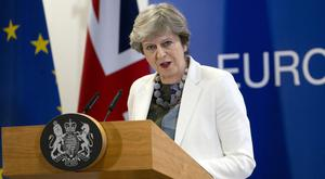 Theresa May during Friday's EU summit in Brussels (Virginia Mayo/AP)