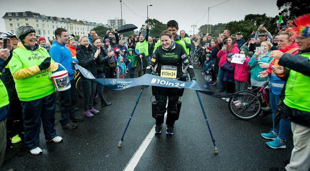 Woman paralysed from chest down triumphs in Great South Run using bionic suit (Great Run/PA)