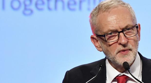 Jeremy Corbyn warns PM her real fight is with 'warring' Tory factions, not EU (Geert Vanden Wijngaert/AP)