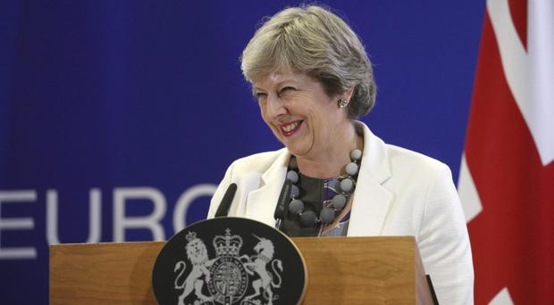 Theresa May says second Brexit referendum is 'out of the question' (Olivier Matthys/AP)