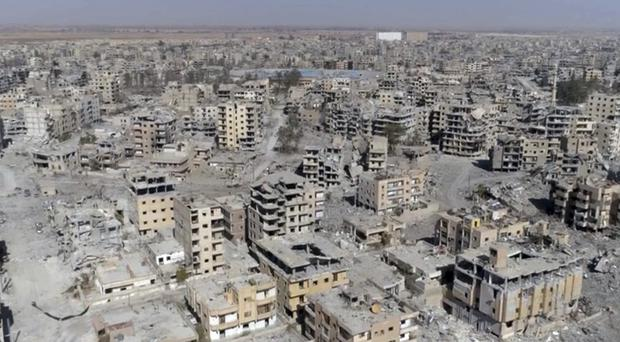 Damaged buildings in Raqqa, Syria, two days after Syrian Democratic Forces took control of the city from IS (Gabriel Chaim/AP)