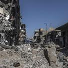 Scenes of devastation in the city of Raqqa (Gabriel Chaim/AP)