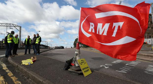 Rail workers to strike next month in disputes over the role of guards (Jonathan Brady/PA)