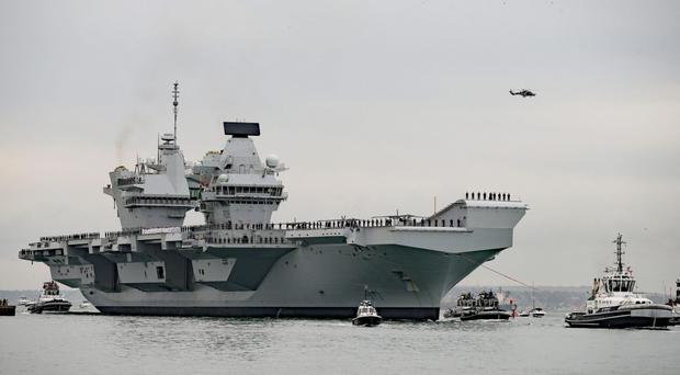 The HMS Queen Elizabeth is scheduled to leave Portsmouth Naval Base at some point in the next few days (Steve Parsons/PA)