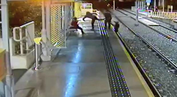 A man was kicked off a tram platform on to the tracks at Didsbury Village Metrolink station (Greater Manchester Police/PA)