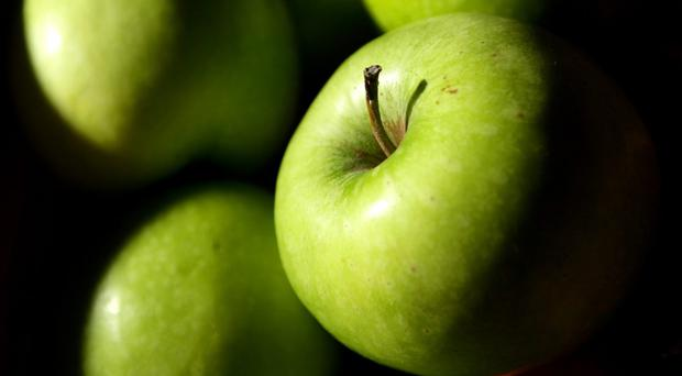 Rinsing apples in water does not remove pesticide residues, study shows (PA Archive)