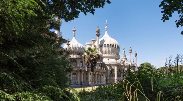 The Royal Pavilion gardens in Brighton have been added to the list of heritage sites at risk (Historic England/PA)