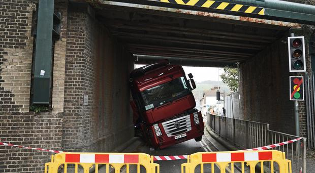 An articulated lorry which hit a bridge in Coombe Valley Road, Dover (Gareth Fuller/PA)