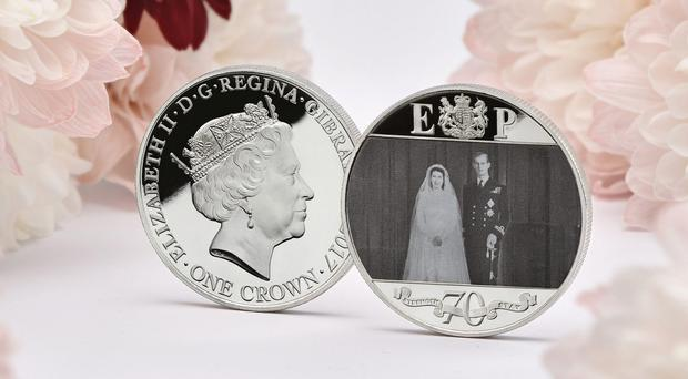 A new coin to commemorate the Queen and the Duke of Edinburgh's platinum wedding anniversary (London Mint Office/PA)