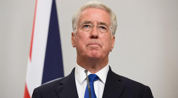 United Kingdom defense minister Fallon resigns, citing past behavior