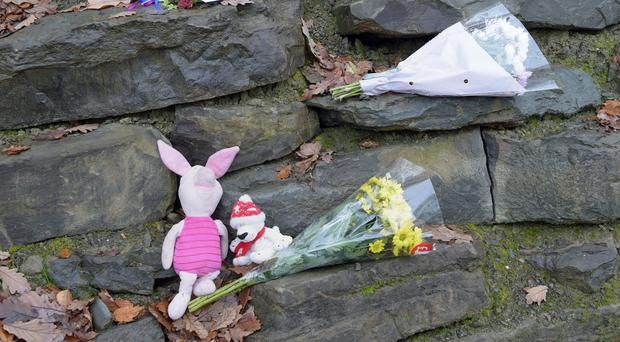 Flowers left close to the scene in Llangammarch Wells, Powys (Ben Birchall/PA)