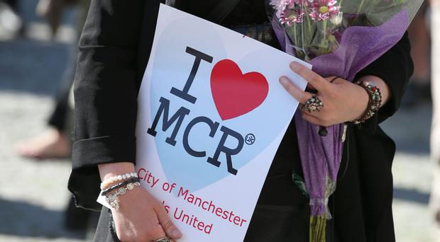 Well-wishers gather at a memorial following the Manchester Arena atrocity (Martin Rickett/PA)