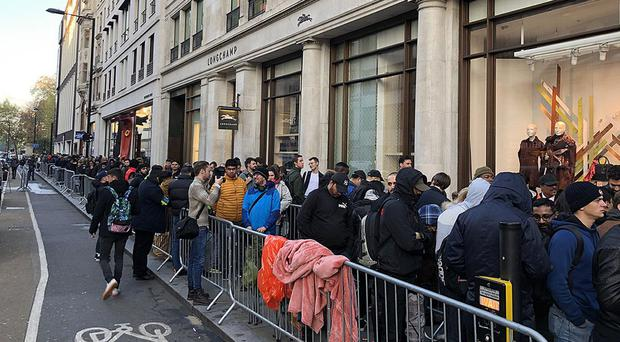 People queue outside the Apple Store on Regent Street, London, as the iPhone X goes on sale (Martyn Landi/PA)
