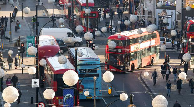 Transport for London has been working since summer last year to reduce the number of buses operating along Oxford Street (Dominic Lipinski/PA)