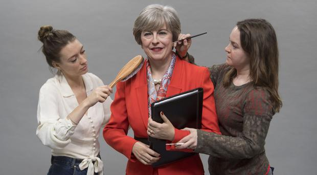 The finishing touches are made to the new wax figure of Prime Minister Theresa May by Rosie Tipler, Costumier, and Amanda Tremewen, Hair and Colour Artist at Madame Tussauds, at the Merlin Magic Making studio in west London (Victoria Jones/PA)