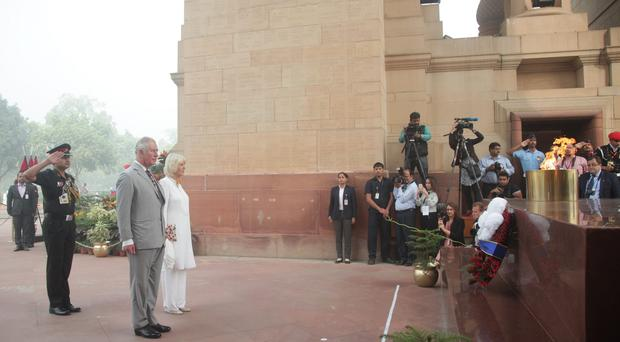 Charles and Camilla during a visit to India Gate for a wreath laying ceremony, in New Delhi (Yui Mok/PA)