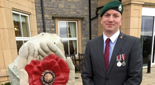 Rob French served as a Royal Marine from 2006 to 2013 (Royal British Legion/PA)