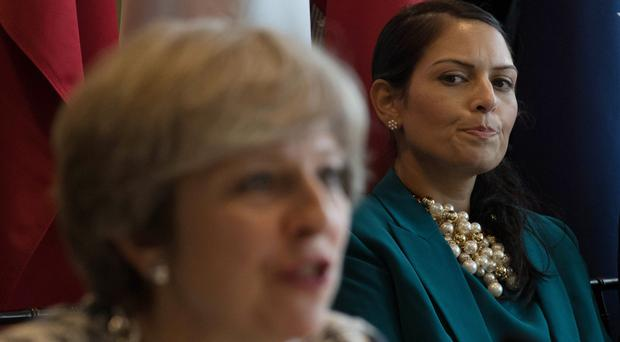 Theresa May will need to find a replacement for Priti Patel (Stefan Rousseau/PA)