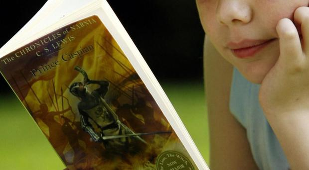 Study authors said that reading was seen as a female hobby (Danny Lawson/PA)